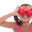 Portrait of a little girl holding hearts — Stock Photo #9766559