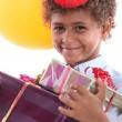 Smiling boy with gifts — Stock Photo