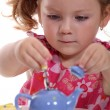 Girl with toy teapot — Stock Photo #9766644