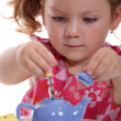 Girl with toy teapot - Photo
