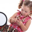 Little girl with necklaces and mirror — Stock Photo