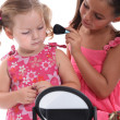 Two little girls playing with make-up - Photo