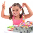 Girl making bead necklace — Stock Photo #9766690