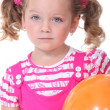 Little girl with orange balloon - Stok fotoğraf