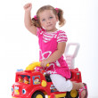 Girl on a toy car — Stock Photo #9766728