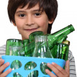 Little boy with glass bottles — Stock Photo