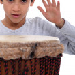 Little boy with bongo drum — Stock Photo