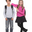 Two school children wearing backpacks — Stock Photo