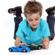 Little boy playing with toy cars — Stock Photo #9767029