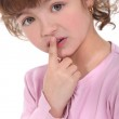 Little girl touching her lips — Stock Photo