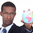 Businessman holding a globe — Stock Photo #9769525