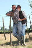 Young couple of farmers — Stock Photo