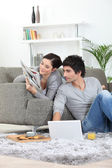 Couple relaxing at home — 图库照片