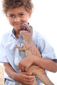 Little boy with toy dinosaur — Stock Photo