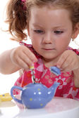 Girl with toy teapot — Stock Photo