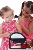 Two little girls playing with make-up — Stok fotoğraf