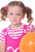 Little girl with orange balloon — Stock Photo