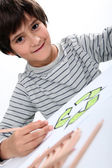 Little boy drawing a circle composed of arrows — Stock Photo
