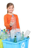 Young girl recycling plastic bottles — Fotografia Stock