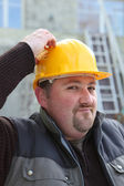 Builder scratching his head — Stock Photo
