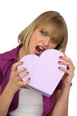 Woman holding a hearth shaped box — Stock Photo