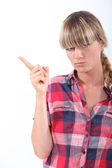 Scolding young woman wagging her finger — Stock Photo