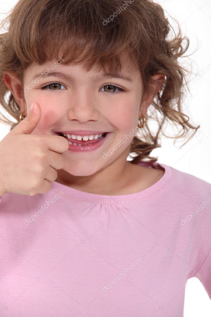 Little girl giving thumbs-up — Stock Photo #9767398