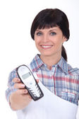Brunette with blue eyes and cordless phone — Stock Photo