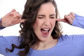 Woman with her fingers in her ears — Stock Photo