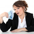 Businesswoman holding bills — Stock Photo #9780046