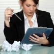 Stockfoto: Businesswomstruggling to write presentation