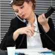 Secretary burdened with two phones — Stock Photo #9780093