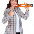 Woman with a spirit level — Stock Photo