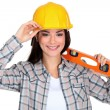 Female worker with a spirit level - Stock Photo