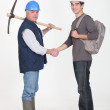 Experienced tradesman meeting his new apprentice for the first time — Stock Photo