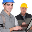 Trainee manual worker with laptop. — Stock Photo #9781973