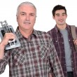 Tiler and a young man — Stock Photo