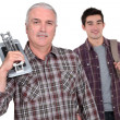 Stock Photo: Tiler and young man