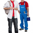 Senior craftsman and apprentice posing - Stock Photo
