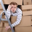 Mstuck behind stacks of cardboard boxes — Stock Photo #9782597