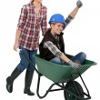 Two female construction workers with wheelbarrow — Stock Photo #9783131