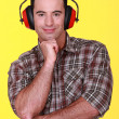 Man wearing ear defenders — Stock Photo #9783405