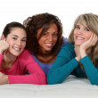 Portrait of three girls resting on white sofa — Stock Photo #9783494