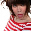 Woman sticking out her tongue — Stock Photo