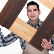 Carpenter building a frame — Stock Photo