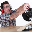 Mstruggling to use mitre saw — Foto Stock #9783918