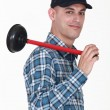 Smiling plumber holding ventouse — Stock Photo