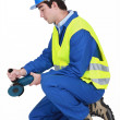 Stock Photo: Contractor using angle grinder