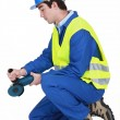 Contractor using angle grinder — Stock Photo #9784293