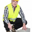 Stock Photo: Bricklayer in reflective vest